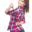 Attractive young woman in a checkered shirt holding strap. Woman - Stock Photo
