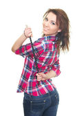 Attractive young woman in a checkered shirt holding strap. Woman — Stock Photo