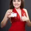 Attractive young woman in a red dress. Woman holds a poster in h — Stock Photo #21630845