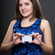 Attractive young woman in a blue dress. Woman holds a small post - Stok fotoğraf