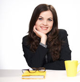 Happy young woman in a black jacket in the office. On the table — Stock Photo