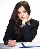 Attractive young woman in a black jacket sitting at the table. W — Stock Photo