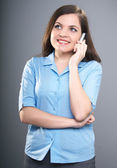 Attractive young woman in a blue shirt. Woman talking on cell ph — Stock Photo