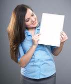 Attractive young woman in a blue shirt. Woman holds a poster and — Stock Photo