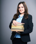 Attractive young woman in a black jacket. Woman holds a books. — Stock Photo