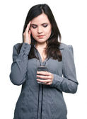 Attractive young woman in a gray blouse suffering from a headach — Stock Photo