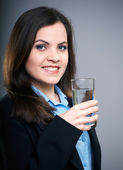 Attractive young woman in a black jacket. Woman holding a glass — Stock Photo