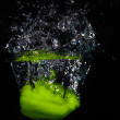 Fresh green paprika falling into the water with a splash of wate — Stock Photo