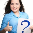 Attractive young woman in a blue shirt. Woman holds a poster wit — Stock Photo