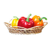 Fresh colorful peppers in basket. — Stock Photo
