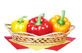 Fresh peppers are in the basket. Isolated on white background — Stock Photo