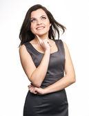 Joven atractiva con un vestido gris de negocios. mujer sostiene — Foto de Stock