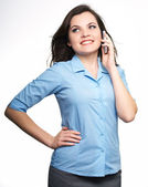 Attractive young woman in a blue blouse. Woman talking on a mobi — Stock Photo