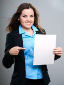 Attractive young woman in a black jacket. Woman holds a poster a — Stock Photo