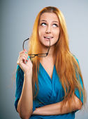 Attractive young woman in a blue dress. Holds glasses and lookin — Stock Photo