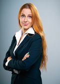 Attractive young woman in a black jacket. Standing with folded h — Stock Photo