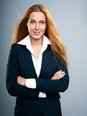 Attractive young woman in a black jacket. Long red hair. — Stock Photo