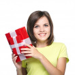 Attractive young woman in a yellow shirt. Holds a gift box. — Stock Photo #31469359