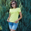 Attractive young woman in a yellow shirt and glasses. Woman in a — Stock Photo #31469385