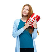 Attractive young woman in a blue shirt. Holds a gift box. Lookin — Stock Photo