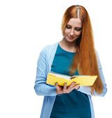 Attractive young woman in a blue shirt. Reads a yellow book. — Stock Photo