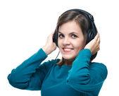 Attraktive junge frau in einem blauen hemd. frau mit kopfhörer li — Stockfoto