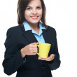 Attractive young woman in a black business suit. Holds a a yello — Stock Photo #31473521