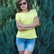 Attractive young woman in a yellow shirt and glasses. Woman in a — Stock Photo #31470071