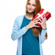 Attractive young woman in a blue shirt. Holds a gift box. — Stock Photo #31470299