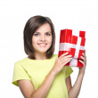 Attractive young woman in a yellow shirt. Holds a gift box. — Stock Photo #31470443