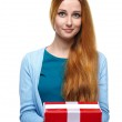 Attractive young woman in a blue shirt. Holds a gift box. — Stock Photo #31470907