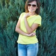 Attractive young woman in a yellow shirt and glasses. Woman in a — Stock Photo #31471315