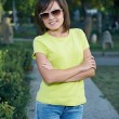 Attractive young woman in a yellow shirt and glasses. Woman in a — Stock Photo #31471549