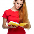 Attractive young woman in a red shirt. Reads a yellow book. — Stock Photo #31471613