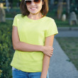 Attractive young woman in a yellow shirt and glasses. Woman in a — Stock Photo #31471739