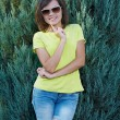 Attractive young woman in a yellow shirt and glasses. Woman in a — Stock Photo #31471757