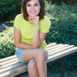 Stock Photo: Attractive young womin yellow shirt. Womin beautiful p
