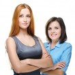 Two attractive girls in business clothes. Standing with folded h — Stock Photo