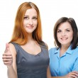 Two attractive girls in business clothes. Showing thumbs up. — Stock Photo