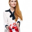 Attractive young woman in a white blouse. Holds a gift box. Isol — Stock Photo #31472369