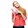 Attractive young woman in a red jacket. Holds a a gift box. — Stock Photo