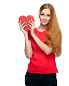 Attractive young woman in a red shirt. Holding red heart. — Foto de Stock