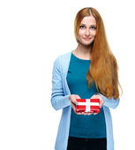 Attractive young woman in a blue shirt. Holds a gift box. — Stock Photo