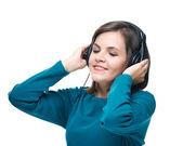 有魅力的年轻女人穿蓝色衬衫。耳机李的女人 — 图库照片
