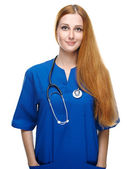 Attractive young nurse with a stethoscope. Isolated on white bac — Stock Photo