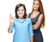 Two attractive girls in business clothes. Shows sign okay. — Stock Photo