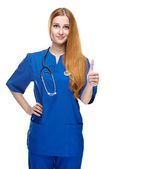 Attractive young nurse in uniform. Showing thumbs up. Isolated o — Stock Photo