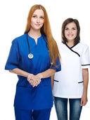 两具吸引力护士的制服。在白色背景上孤立 — 图库照片