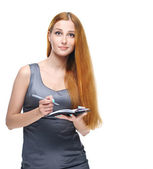 Attractive young woman in a gray business dress. Keep a notepad — Stock Photo
