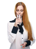 Attractive young woman in a white blouse. Holding a glass of min — Stock Photo